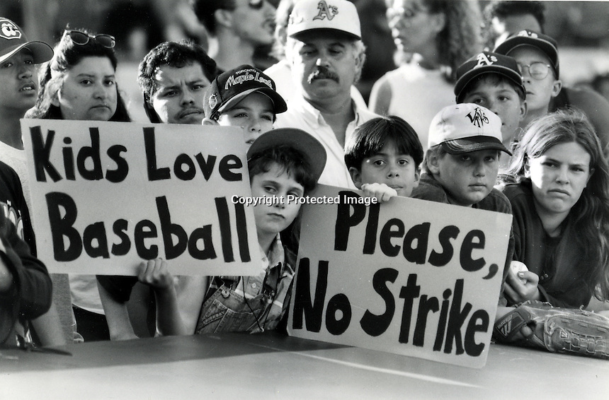 Oakland Athletics fans asking for no strike in August 1994..before major league baseball players when on strike, (photo Ron Riesterer/photoshelter)