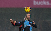 Michael Harriman of Wycombe Wanderers wins the ball in the air during the Sky Bet League 2 match between Wycombe Wanderers and Morecambe at Adams Park, High Wycombe, England on 2 January 2016. Photo by Andy Rowland / PRiME Media Images
