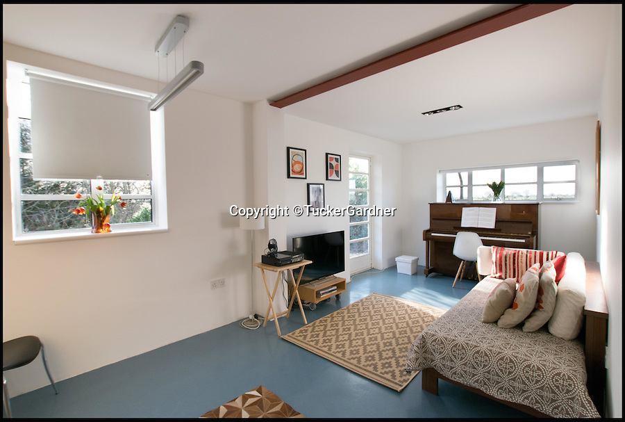 BNPS.co.uk (01202 558833)<br /> Pic: TuckerGardner/BNPS<br /> <br /> The living area.<br /> <br /> Potential buyers are scrambling to view a unique RAF control tower that has appeared on the property radar near Saffron Walden in Essex.<br /> <br /> A Second World War tower has been transformed into a stylish family home and is now on the market for &pound;775,000.<br /> <br /> Little Walden airfield in Essex was opened in 1944 and the base was home to American Mustang fighters and B17 Flying Fortresses throughout the war.<br /> <br /> It is now a four-bedroom home with a wrap-around balcony and access to the rooftop to make the most of the panoramic views of the surrounding open countryside.<br /> <br /> Although in its secluded rural location the only flypast your likely to see nowadays is of the feathered variety.