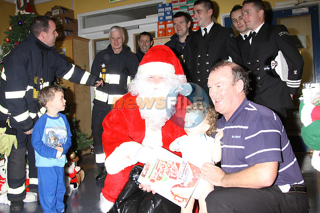 Members of the Drogheda fire Service and Irish Coast Guard Drogheda Unit presenting a cheque to the children's ward in Our Lady of Lourdes Hospital for the purchase of equipment for the children. The monies were raised from the sponsored football match held in the Drogheda leisure park Between the two organisations. Santa Arrived after hitching a lift in the Irish Coast guard boat and being escorted by the Fire Service, to deliver the presents and cheque to the staff..Photo: Fran Caffrey/www.newsfile.ie...
