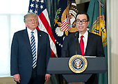 United States Secretary of the Treasury Steven Mnuchin makes remarks prior to US President Donald J. Trump signing Executive Orders concerning financial services at the Department of the Treasury in Washington, DC on April 21, 2017.<br /> Credit: Ron Sachs / Pool via CNP