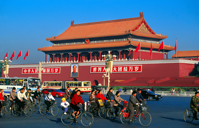 Bicycle traffic on Dong Chang' An Jie Street (Tiananmen Gate in background), Beijing, China