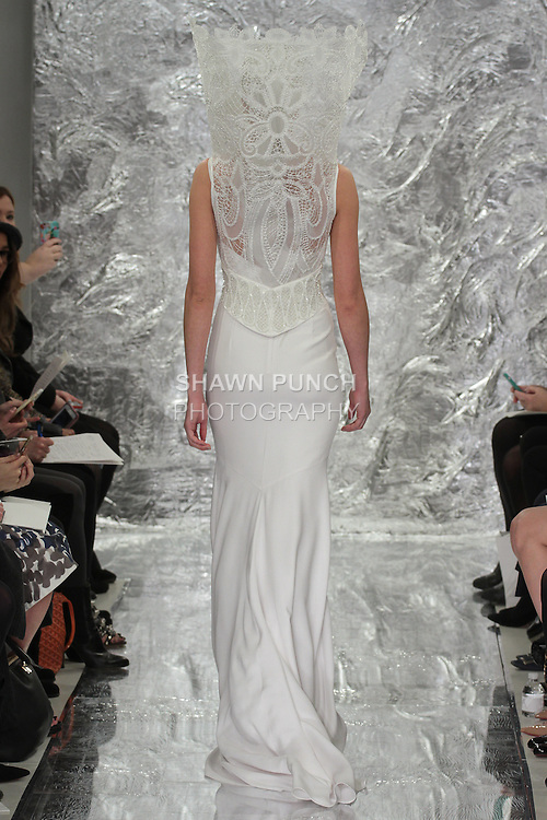 Model Aida Aniulyte walks runway in Ashoka - a white silk crepe slip dress with fractal patterned raffia embroidered vortex collar jacket, from the Theia Spring 2017 bridal collection by Don O'Neill, during New York Bridal Fashion Week Spring Summer 2017 on April 14, 2016.