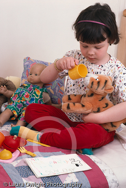 preschool age girl  4 years old pretend play: tea party w. dolls & stuffed animals