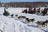Sunday, March 4, 2012  Jeff King runs on Long Lake past spectators on a picnic at the restart of Iditarod 2012 in Willow, Alaska.