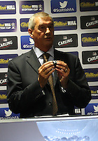 Scottish FA President Campbell Ogilvie showing the ball assigned to Threave Rovers after being drawn at home for the Scottish Cup 1st Round which took place at Hampden Park, Glasgow on 8.8.13.