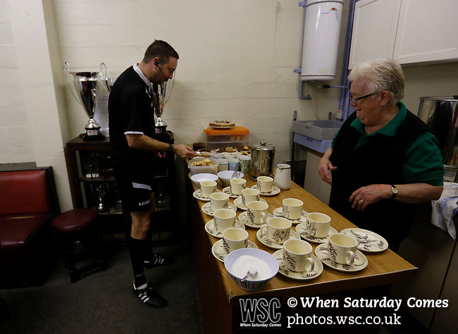 Aberystwyth Town 1 Newtown 2, 17/05/2015. Park Avenue, Europa League Play Off final. Nick Pratt the fourth official has a pre match cup of tea. Aberystwyth finished 14 points above Newtown in the Welsh Premier League, but were beaten 1-2 in the Play Off Final. Photo by Paul Thompson.
