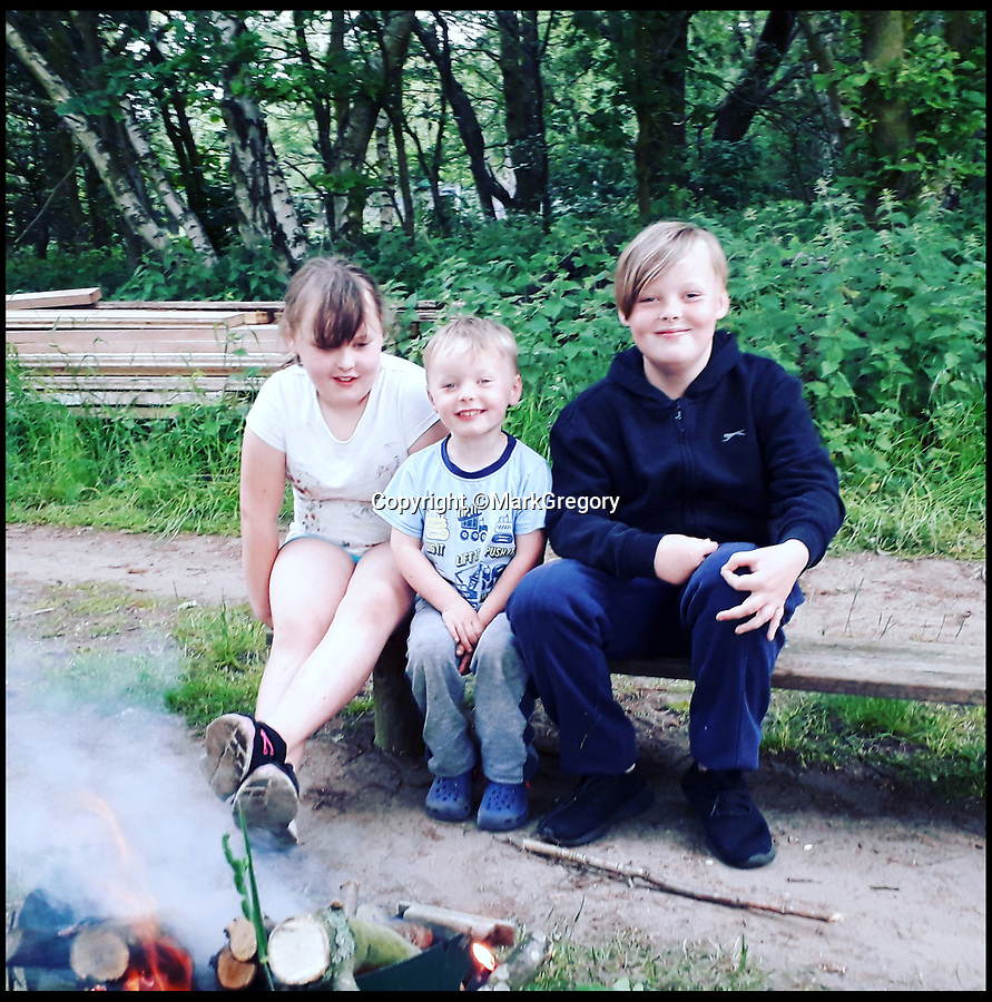 BNPS.co.uk (01202 558833)<br />Pic:     MarkGregory/BNPS<br /> <br /> Connor Gregory (centre) who caught the huge turtle, pictured with sister Lucie and brother Callum.<br /> <br /> A young angler has been lauded for capturing an enormous turtle that had been wreaking havoc at a carp fishing lake.<br /> <br /> Myrtle the Turtle had previously been flying under the radar of bosses at Mesters Lake near Scunthorpe, Lincs, biting the tails off tench fish.<br /> <br /> The mystery of what was causing the gruesome injuries was stumping experts before Myrtle was discovered by four-year-old Connor Brocklesby.