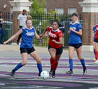 Graham Thomas/Herald-Leader<br /> Former Siloam Springs standout Laura Morales runs by a pair of East defenders during the Arkansas High School Coaches Association All-Star Girls Soccer Game at Estes Stadium on the campus of the University of Central Arkansas in Conway.