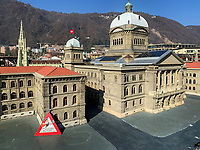 Switzerland. Canton Ticino. Melide. SwissMiniatur is a miniature park in in Melide, distant 7.5 km from Lugano.SwissMiniatur features a 14,000 m2 reproduction of 120 buildings, monuments and sites in Switzerland in miniature on a scale of 1:25. The Federal Palace (German: Bundeshaus, French: Palais fédéral, Italian: Palazzo federale, Romansh: Chasa federala, Latin: Curia Confœderationis Helveticæ) refers to the building in Bern housing the Swiss Federal Assembly (legislature) and the Federal Council (executive). It consists of a central assembly building and two wings (eastern and western) housing government departments and a library. The two chambers where the National Council and the Council of States meet are separated by the Hall of the Dome. The dome itself has an external height of 64 m, and an internal height of 33 m. The mosaic in the center represents the federal coat of arms along with the Latin motto Unus pro omnibus, omnes pro uno (One for all, and all for one), surrounded by the coat of arms of the 22 cantons that existed in 1902. The coat of arms of the Canton of Jura, created in 1979, was placed outside of the mosaic. A sign indicates that the model being repaired. 21.02.2019 © 2019 Didier Ruef