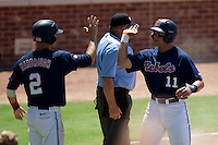 Outfielder Zach Kirksey #11 of the Ole Miss Rebels is greeted by teammate Alex Yarbrough #2 after he scored a run during the NCAA Regional baseball game against the Texas Christian University Horned Frogs on June 1, 2012 at Blue Bell Park in College Station, Texas. Ole Miss defeated TCU 6-2. (Andrew Woolley/Four Seam Images)