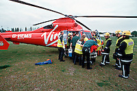 HEMS, helicopter emergency medical service, paramedics and doctors and ambulance crews along with firefighters load a patient onto the helicopter on a stretcher to rush him to the crash room of the A&E department of a hospital. This image may only be used to portray the subject in a positive manner..©shoutpictures.com..john@shoutpictures.com