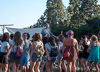 """Students enjoy Spring Fest 2015 Pre-show activities on Stewie Beach and the Braun parking lot. The event included food trucks, a bounce house, a beer garden, live entertainment from the band """"Dinner"""", and more. (Photo by Nick Harrington, Occidental College Class of 2017)"""