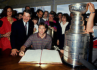 Montreal (Qc) CANADA - 1993 File Photo (exact date unknown)<br /> <br /> Mayor Jean Dore look while<br /> Canadien goaler Patrick Roy sign Montreal City Golden book, after the 1993 Stanley Cup Victory.