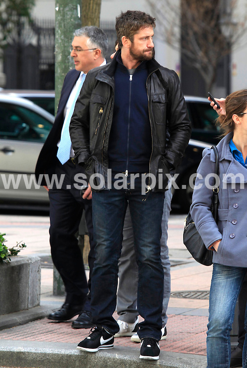 **ALL ROUND PICTURES FROM SOLARPIX.COM**.**UK SYNDICATION RIGHTS ONLY**.Gerard Butler out for dinner in Madrid, Spain, after the photo-call for his new film The Bounty Hunter. The star took some time out in the centre of the city, before the screening of the film later that evening, and grabbed himself a coffee on the go. Madrid, Spain. 30 March 2010...This pic: Gerard Butler ..JOB REF: 11014 SKX      DATE:  30_03_2010.**MUST CREDIT SOLARPIX.COM OR DOUBLE FEE WILL BE CHARGED**.**MUST NOTIFY SOLARPIX OF ONLINE USAGE**.**CALL US ON: +34 952 811 768 or LOW RATE FROM UK 0844 617 7637**