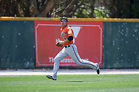 Baltimore Orioles Guiyuan Xu (30) tracks a fly ball during a minor league Spring Training game against the Tampa Bay Rays on March 29, 2017 at the Buck O'Neil Baseball Complex in Sarasota, Florida.  (Mike Janes/Four Seam Images)