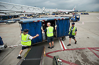 American Airlines Fleet Service Clerks prepare to unload baggage onto a plane at Dallas-Fort Worth International Airport (DFW) in Dallas, Texas, Friday, May 14, 2010. ..PHOTO: MATT NAGER