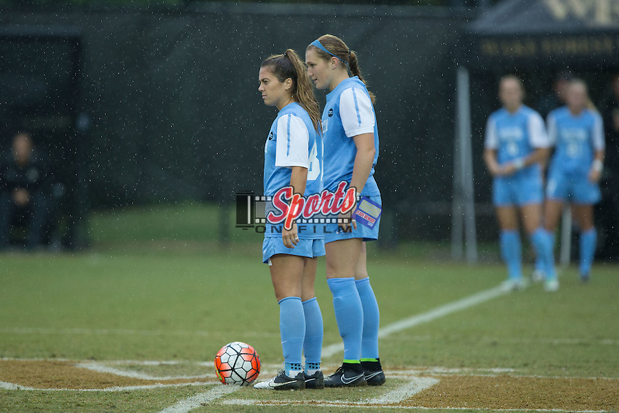 Alexa Newfield (88) and Jessie Scarpa (12) wait for the whistle to start play against the Wake Forest Demon Deacons at Spry Soccer Stadium on September 27, 2015 in Winston-Salem, North Carolina.  The Tar Heels defeated the Demon Deacons 1-0.  (Brian Westerholt/Sports On Film)