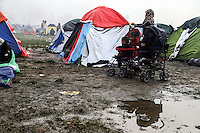 Pictured: Young children in pushchairs by a flooded field in the camp Tuesday 08 March 2016<br />