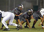 Torrance, CA 09/25/15 - Ryan Carroll (Torrance #2) and Joshua Molina (Torrance #74) in action during the El Segundo - Torrance varsity football game at Zamperini Field of Torrance High School