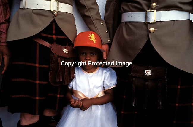 dicuafr00028 Culture Afrikaners A black girl with a transvaal hat at an re-enactment of the defence of Rorke's drift, a big battle from the Anglo-Boer war, during a yearly performance on September 27, 2002 in Dundee in Natal province, South Africa. .Photo: Per-Anders Pettersson/iAfrika Photos