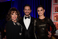 BEVERLY HILLS - JANUARY 6: (L-R) Joan Collins, Edgar Ramirez and Penelope Cruz attend the 2019 Fox Nominee Party for the 76th Annual Golden Globe Awards at the Fox Terrace on the Roof Deck of the Beverly Hilton on January 6, 2019, in Beverly Hills, California. (Photo by Frank Micelotta/Fox/PictureGroup)