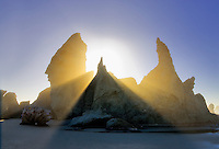 Sea stacks at Bandon Beach with fog and sun rays. Oregon