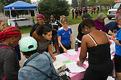 Runners and walkers came together Saturday to help promote awareness for breast cancer screenings during the 2016 Hyde Park Breast Cancer Walk / Run along the lakefront. <br /> <br /> 5347 &ndash; Executive Director for the Hyde Park Neighborhood Club, Sarah Diwan registers for the event.<br /> <br /> Please 'Like' &quot;Spencer Bibbs Photography&quot; on Facebook.<br /> <br /> All rights to this photo are owned by Spencer Bibbs of Spencer Bibbs Photography and may only be used in any way shape or form, whole or in part with written permission by the owner of the photo, Spencer Bibbs.<br /> <br /> For all of your photography needs, please contact Spencer Bibbs at 773-895-4744. I can also be reached in the following ways:<br /> <br /> Website &ndash; www.spbdigitalconcepts.photoshelter.com<br /> <br /> Text - Text &ldquo;Spencer Bibbs&rdquo; to 72727<br /> <br /> Email &ndash; spencerbibbsphotography@yahoo.com