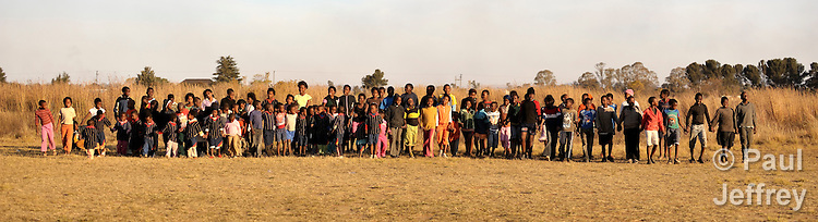 Children and youth who participate in an after school program sponsored by the Inkanyezi ART Project, which is funded by the South African Catholic Bishops' Conference. Participants include orphans and other other vulnerable children who are living with or affected by HIV and AIDS. The program is carried out in the St. Louis Catholic Church in Orange Farm, South Africa.