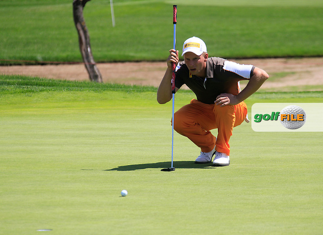 Marcel Siem (GER) lines up his putt on the 15th green during Sunday's Final Round of the Open de Espana at Real Club de Golf de Sevilla, Seville, Spain, 6th May 2012 (Photo Eoin Clarke/www.golffile.ie)