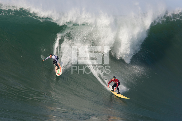 Ryan Seelbach, right and Ross Clarke-Jones, left, take off on a wave during the 2008 Mavericks Surf Contest in Half Moon Bay, Calif., Saturday, January 12, 2008.