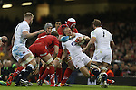 Wales lock Jake Ball ushers England fullback Mike Brown into touch.<br /> 2015 RBS 6 Nations<br /> Wales v England<br /> Millennium Stadium <br /> 06.02.15<br /> ©Steve Pope -SPORTINGWALES