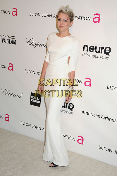 Miley Cyrus (wearing Azzaro).21st Annual Elton John Academy Awards Viewing Party held at West Hollywood Park, West Hollywood, California, USA..February 24th, 2013.oscars full length dress white long sleeves diamond bracelets .CAP/ADM/BP.©Byron Purvis/AdMedia/Capital Pictures.