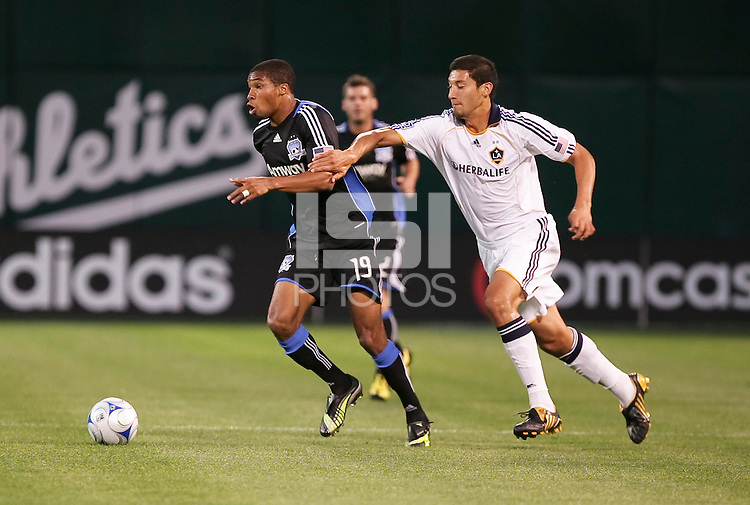Ryan Johnson (19) dribbles the ball ahead of Omar Gonzalez (4). San Jose Earthquakes tied Los Angeles Galaxy 1-1 at the McAfee Colisum in Oakland, California on April 18, 2009.