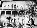 Iraq 1930  .Mulla Effendi with two sons on the balcony of his house in Erbil  .<br /> Irak 1930 .Mulla Effendi avec ses 2 fils au balcon de sa maison a Erbil