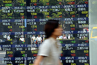 Businessmen are reflcted in a Stock Exchange Screen board at Otamachi in Tokyo. Stocks fell in Japan after the surprise resignation of Japanese Prime Minister Yasuo Fukuda,  September 1st, 2008..