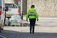Pictured: A police officer patrols the lane near the slipway where the Mini car with Kiara Moore entered river Teifi from in Cardigan, west Wales, UK. Tuesday 20 March 2018<br /> Re: The funeral of two year old Kiara Moore, who died after being recovered from a silver Mini car found in river Teifi in Cardigan will be held today (Tue 27 Mar 2018) at Parc Gwyn Crematorium, Narberth, west Wales.<br /> Kiara was taken at the University Hospital of Wales in Cardiff after being rescued but was pronounced dead.<br /> It is believed the car she was in, rolled down a slipway while her mother got out momentarily to get cash out of the family business premises.<br /> Her parents Jet Moore and Kim Rowlands have expressed their grief on social media.