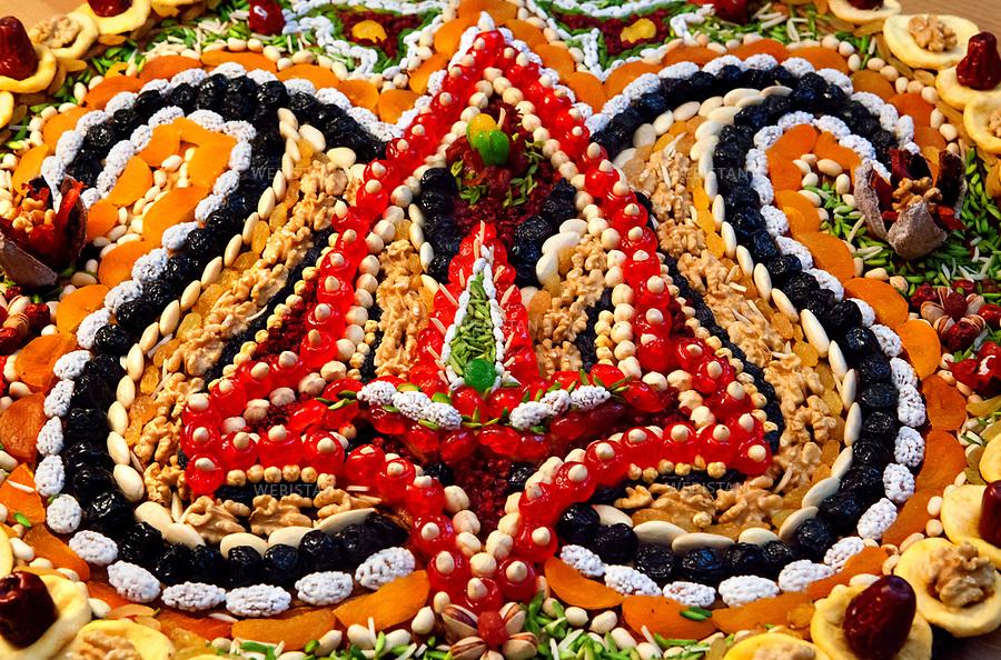 Azerbaijan, Baku, Old City, March 20, 2011<br /> A traditional Novruz cake made of dried fruits and nuts. The cake is covered with droplet-shaped motifs called Buta. Buta is one of the symbols of Azerbaijan. The history of Novruz in Azerbaijan - which means &quot;new day&quot; and marks the spring holiday that celebrates the revival of nature, moral purity and equality, goes back millennia. The holiday is officially registered on UNESCO&rsquo;s List of Intangible Cultural Heritage.<br /> <br /> Azerba&iuml;djan, Bakou, Vieille Ville, 20 mars 2011<br /> Un g&acirc;teau traditionnel de Novrouz compos&eacute; de fruits secs et de noix. Des motifs en forme de gouttelette appel&eacute;s &laquo; buta &raquo; se trouvent sur le g&acirc;teau. Le buta est l&rsquo;un des symboles de l&rsquo;Azerba&iuml;djan. L&rsquo;histoire de Novrouz en Azerba&iuml;djan &ndash; dont le nom signifie &quot;jour nouveau&quot; et qui marque les vacances de printemps, c&eacute;l&egrave;brant le renouveau de la nature, la puret&eacute; morale et l&rsquo;&eacute;galit&eacute;, remonte &agrave; plusieurs mill&eacute;naires. La f&ecirc;te est officiellement enregistr&eacute;e sur la liste du Patrimoine culturel immat&eacute;riel de l&rsquo;UNESCO.