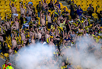 Yellow Fever fans get their shirts off while 1-0 up in the 80th minute, before putting them back on two minutes later, when Diego Costa equalised during the A-League football match between Wellington Phoenix and Perth Glory at Westpac Stadium in Wellington, New Zealand on Saturday, 2 December 2018. Photo: Dave Lintott / lintottphoto.co.nz