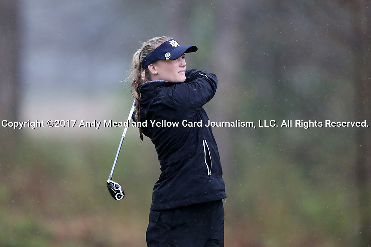 BROWNS SUMMIT, NC - MARCH 31: Notre Dame's Maddie Rose Hamilton tees off on the 12th hole. The first round of the Bryan National Collegiate Women's Golf Tournament was held on March 31, 2017, at the Bryan Park Champions Course in Browns Summit, NC. A waterlogged course eventually suspended play.