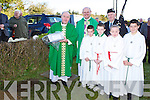 Fr Kevin McNamara burying the time capsule in the grounds of the church in Gneeveguilla on Sunday was Salesian Priest Dan Carroll, Damian O'Halloran, Jake Fleming, Michelle Fleming and Daniel Fleming..