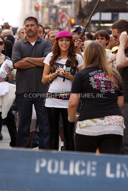 WWW.ACEPIXS.COM . . . . .  ....July 18 2008, New York City....Singer and actress Miley Cyrus was out in Times Square to tape a segment for MTV's 'TRL' show on July 18 2008 in New York City....Please byline: AJ Sokalner - ACEPIXS.COM..... *** ***..Ace Pictures, Inc:  ..te: (646) 769 0430..e-mail: info@acepixs.com..web: http://www.acepixs.com