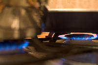Elements on a gas stove heating up.