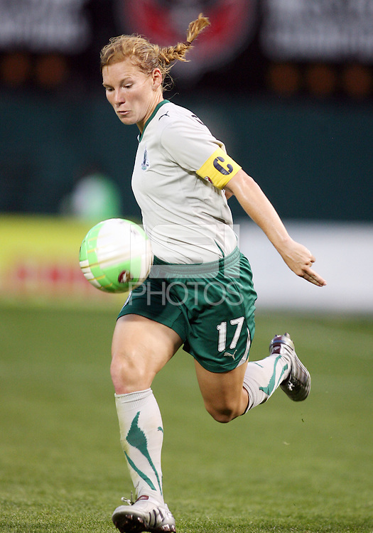 Lori Chalupny #17 of St. Louis Athletica nudges the ball forward during a WPS match against the Washington Freedom  on May 1 2010, at RFK Stadium, in Washington D.C.Freedom won 3-1.