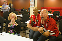 San Francisco, CA - Tuesday, July 1, 2014: Employees at Arthur J. Gallagher insurance company, including Zack Phillips (right), watch the USA vs. Belgium World Cup Round of 16 game in San Francisco.