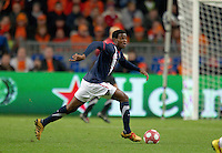 Maurice Edu carries the ball. .The USA men fell to the Netherlands 2-1 at Amsterdam ArenA, Wednesday, March 3, 2010.