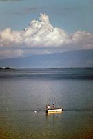 Fishing off Kaunakakai harbor with Lanai in the background