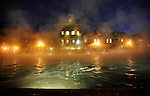 Mist rolls off the warm water as a lone swimmer enjoys a cold Colorado night in the 90 degree waters of the main pool of the Hot Springs Pool & Lodge in Glenwood Springs, CO. A smaller pool is kept at 104 degrees. Michael Brands for The New York Times.