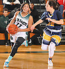 Aisha Smikle #11 of Farmingdale, left, looks to drive to the net as Annie Leone #22 of Massapequa guards her during a Nassau County varsity girls basketball game at Farmingdale High School on Saturday, Jan. 28, 2017. Massapequa won 47-44 in overtime.