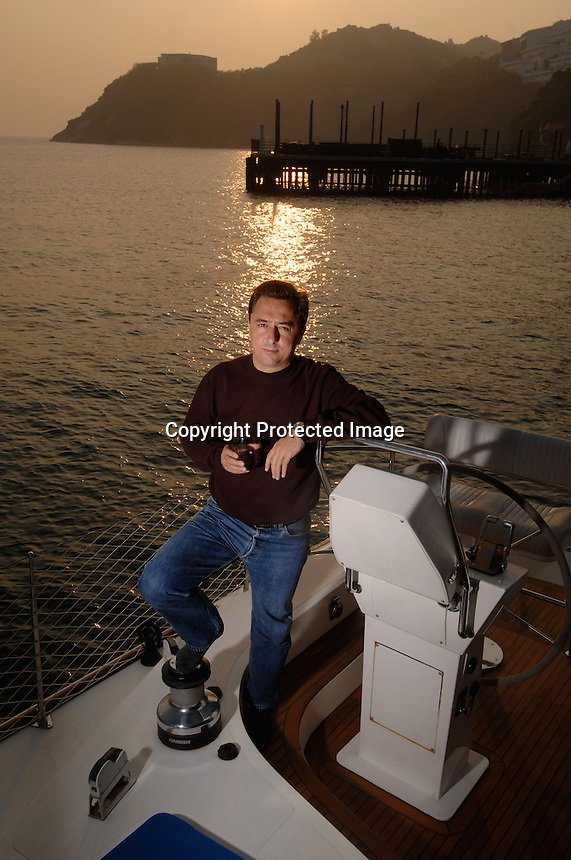 Chris Lenz, 40, founder and CEO of Igor's Group, poses on his catermaran in Stanley Harbour, Hong Kong.  Mr Lenz has just sold his restaurants making himslef a rich man. He plans to retire to Thailand.
